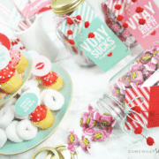 setting up a galentines day party with colorful printables and mini donuts