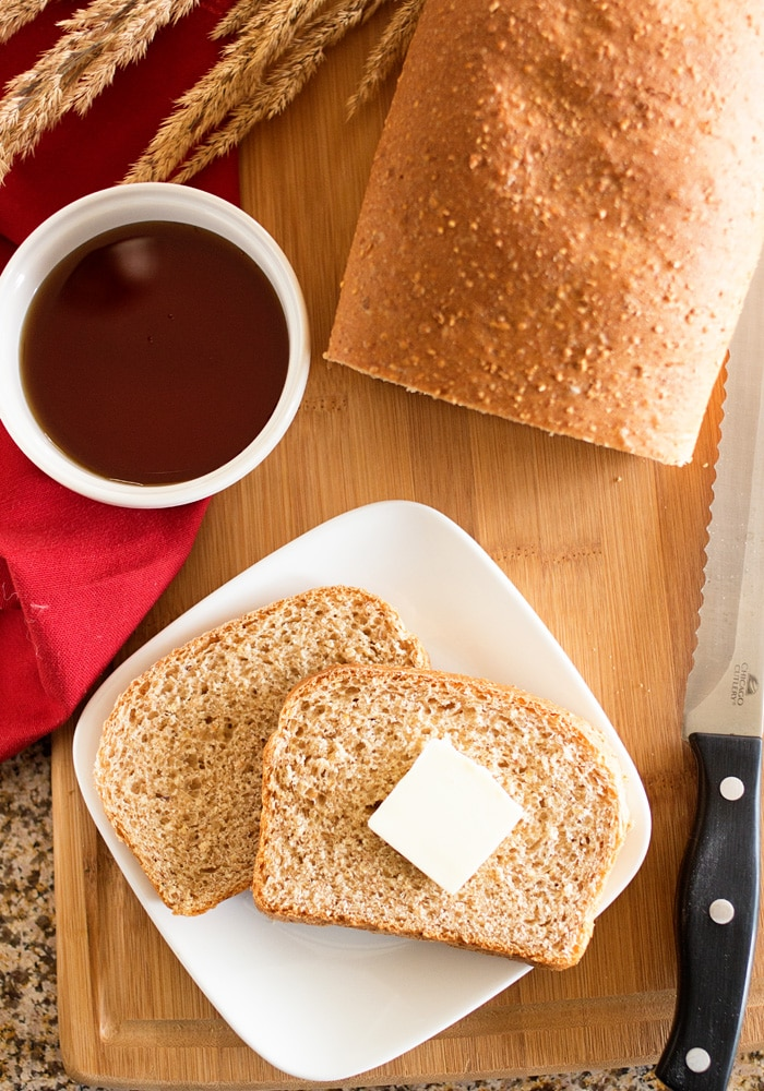 This hearty nine-grain whole wheat bread recipe is healthy and delicious. Even if you use five grains or just three, this hearty bread does not disappoint!