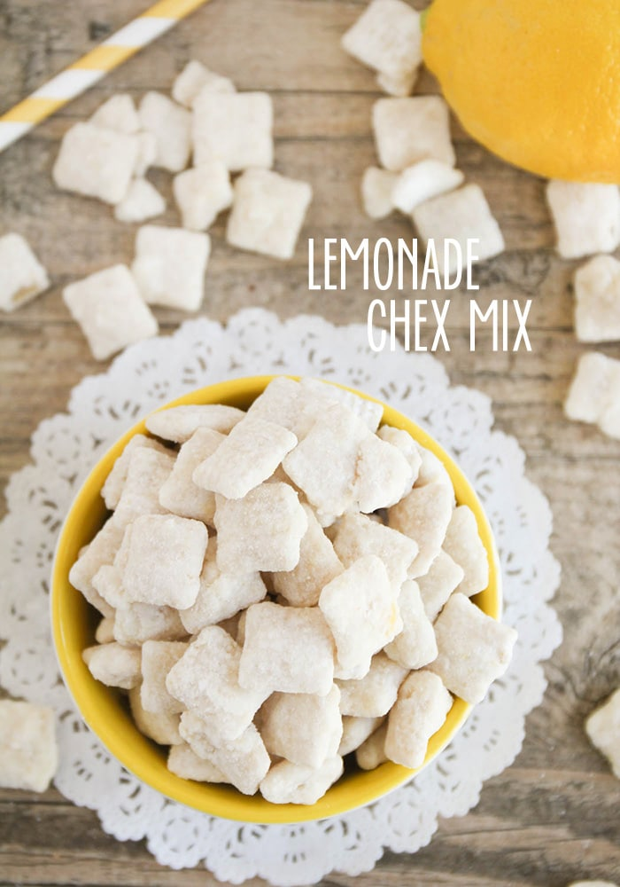 looking down on a bowl of Lemon Chex Mix on a table with the words lemonade check mix overlayed on the picture