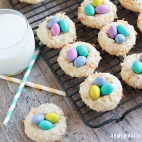 Birds Nest Cookies next to a glass of milk with two paper straws