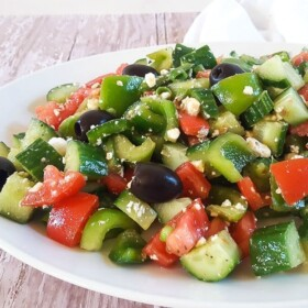 This Greek Salad recipe is full of hearty and bold flavors, but it's a cinch to pull together. Serve it as a side dish or even as a light dinner!