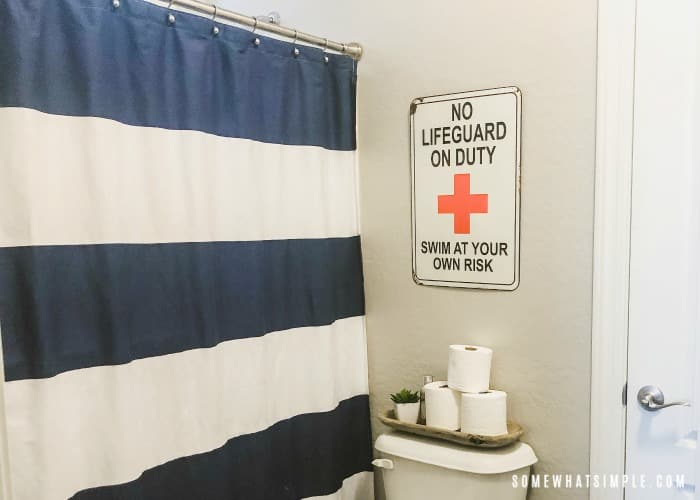 Boys Bathroom with navy and white striped shower curtain