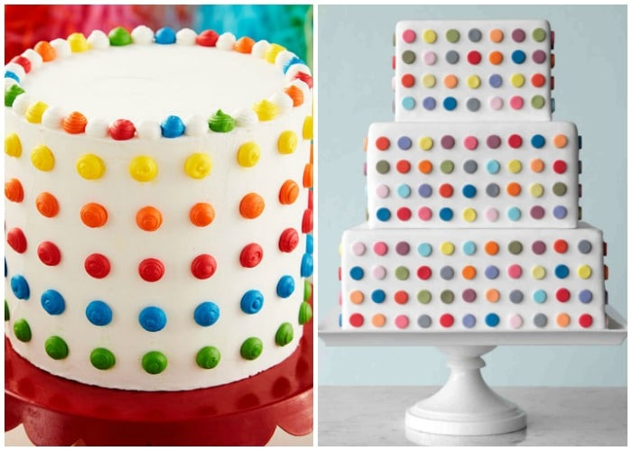 two large cakes with white frosting that have brightly colored polka dots