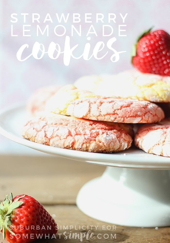 pink lemonade cookies stacking on a white cake stand with a strawberry on top and another strawberry on the counter below. The words strawberry lemonade cookies is written in white letters at the top of the image.
