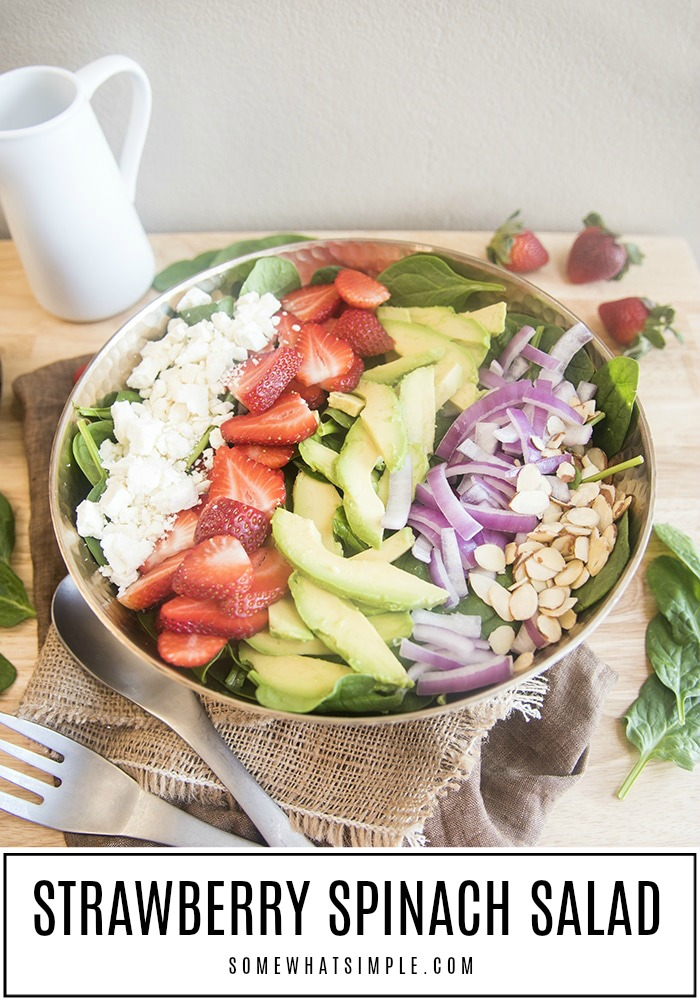 This strawberry spinach salad is packed full of delicious ingredients! Sweet strawberries, tangy red onion, creamy avocado, crumbled feta and crunchy sliced almonds. (Are you hungry yet?) #salad #recipe #fresh #fruit #vegetables #strawberrysalad #strawberryspinach via @somewhatsimple
