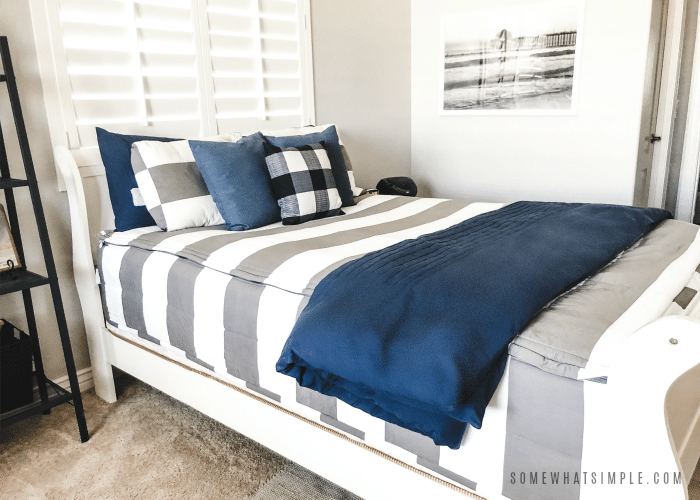 teen boy bedding - gray and white striped bedding with navy blue throw