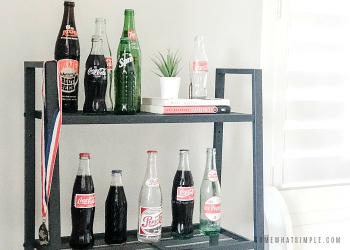 teen boys bedroom shelf with vintage soda bottles lined up