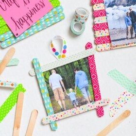 These colorful washi tape popsicle stick frames are so much fun to make with the kids to give as gifts or hang on the fridge.