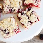 a cookie stand filled with Blackberry Crumble Bars