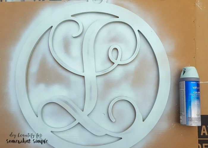 Spray paint a brand new item to make it work for your home, like I did with this monogram door hanger!
