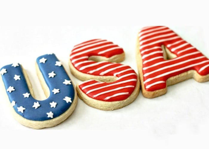 Three sugar cookies that spell out USA and decorated with patriotic colors are perfect for the 4th of July
