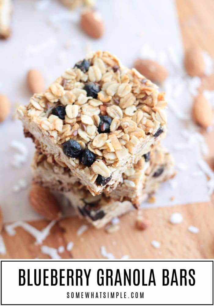 3 blueberry granola bar squares stacked on top of each other