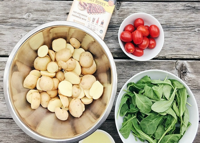 bowls with potatoes, tomatoes and arugula