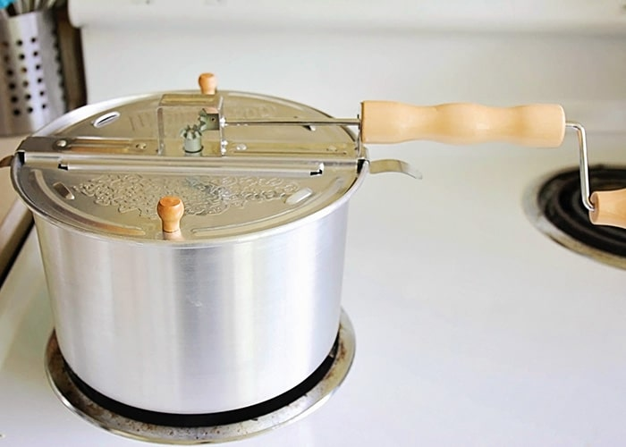 a whirley pop pot on a stove