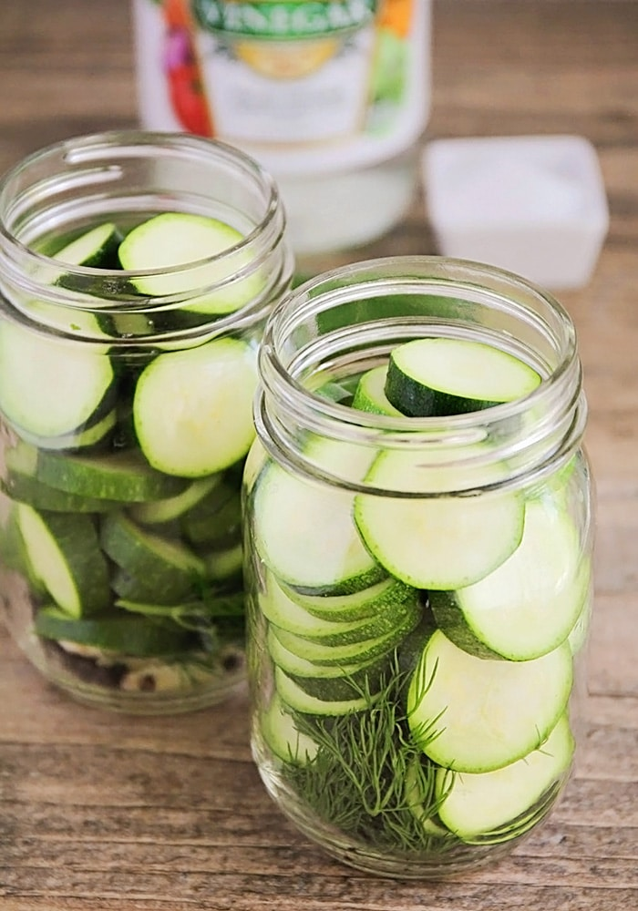 jars filled with zucchini pickles