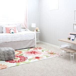 a little girl's bedroom that's been decorated with light pink colors