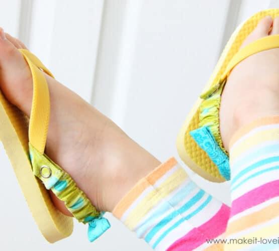 little girl wearing flip flops with her legs crossed