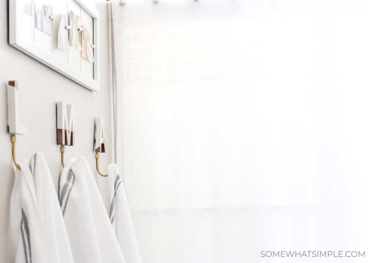 towels hanging from individual monogram towel racks