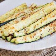 Baked Parmesan Zucchini spears on a plate