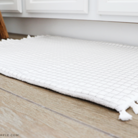 a DIY Bath Mat on the floor in the bathroom