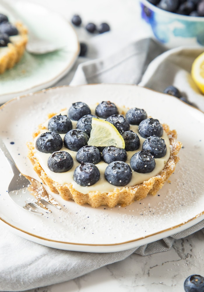 These refreshing, no-bake Lemon and Blueberry Tartlets are packed with citrus goodness and topped with juicy blueberries creating one amazing Summer dessert!