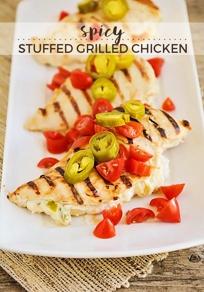 These spicy stuffed grilled chicken breasts are the perfect summer meal! Sodelicious and flavorful, and so easy to make on the grill! via @somewhatsimple