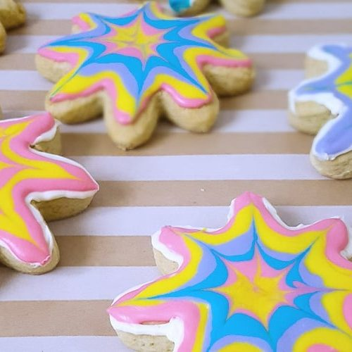 Tie dye sugar cookies are a fun and delicious way to celebrate the colors of summer!