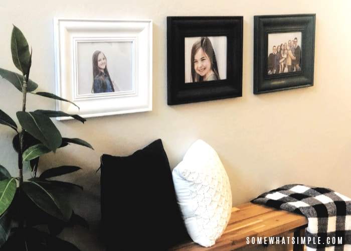 three different colored picture frames on a wall