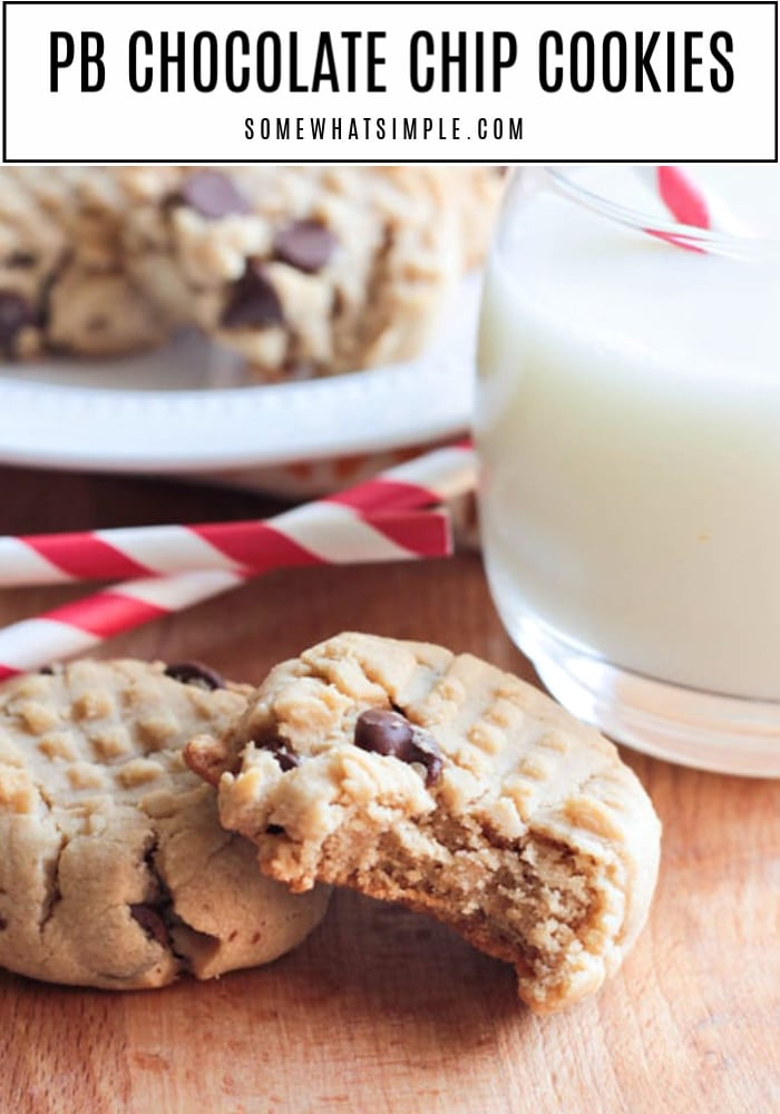 peanut butter cookies sitting on a table next to a glass of milk
