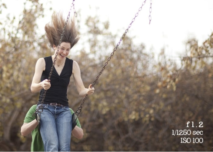 fast shutter speed with girl on swings