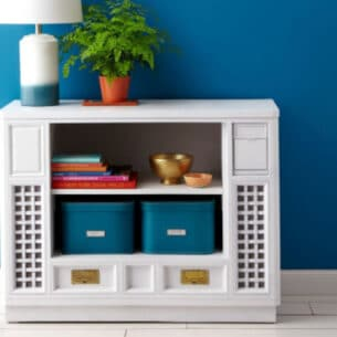 an upcycled tv cabinet turned into a shelf with baskets