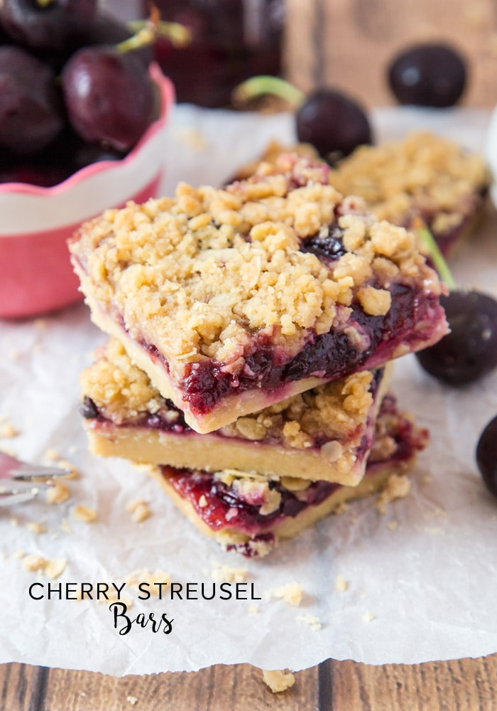 These amazing Cherry Streusel Bars have a buttery shortbread base, topped with cherry jam, fresh cherries and a crumbly topping!