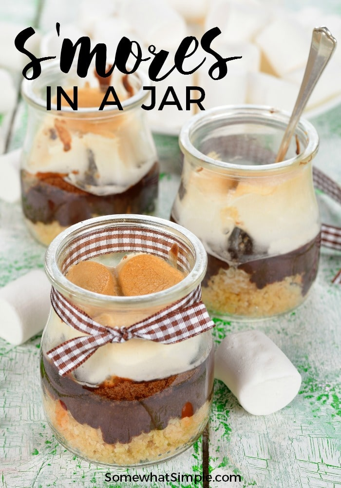 Ready for a delicious treat your kids are going to LOVE??? Chocolate, marshmallows and graham crackers - all the flavors from a classic s'more, but super simple to put together and practically mess-free! These s'mores in a jar are a perfect summer treat! #smores #camping #smoresinajar via @somewhatsimple
