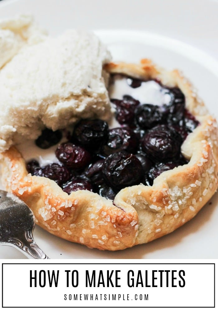 a close up of a galette filled with blueberries and topped with a scoop of ice cream