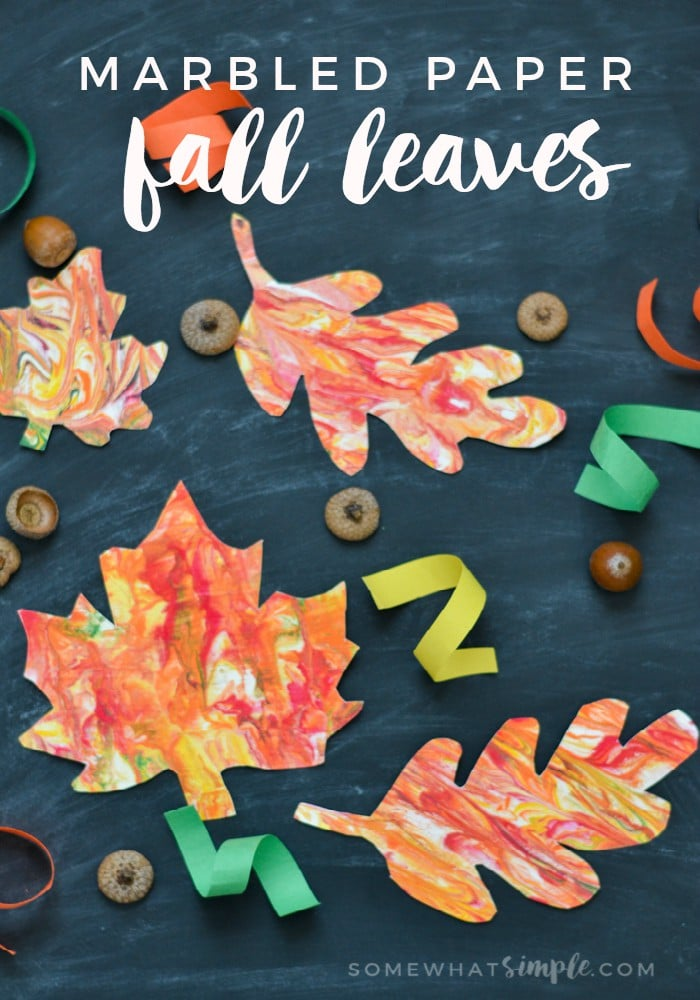 A fun fall craft project to make with the kids, create these one-of-a-kind marbled paper fall leaves to hang up around the house! via @somewhatsimple