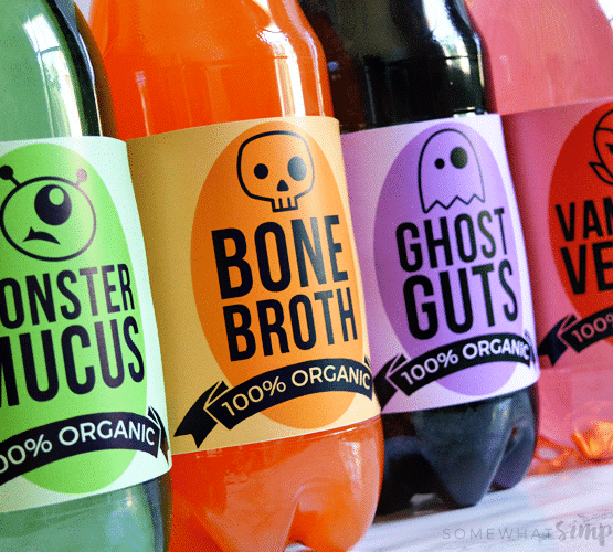 4 soda bottles that are wrapped in Halloween themed drink Labels printable