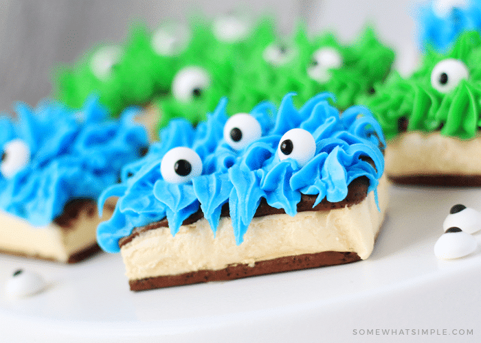 ice cream sandwich monsters made with blue and green frosting and candy eyes