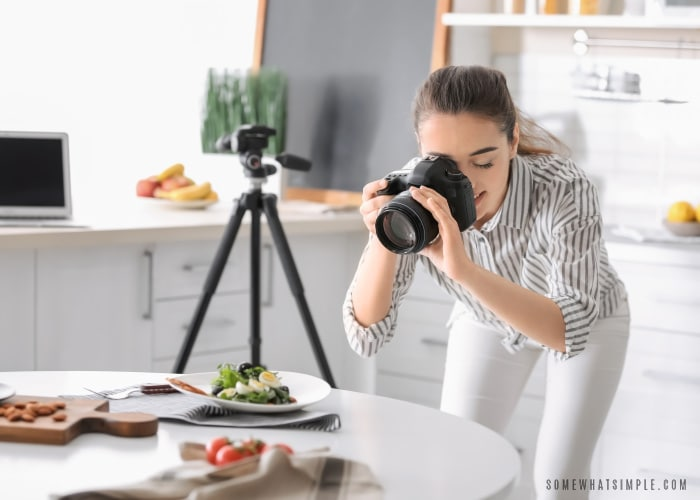 Food blogger shooting a plate of food