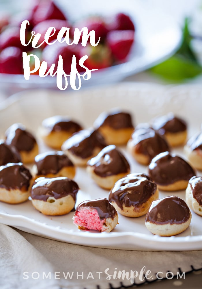 Beautiful strawberry-filled cream puffs dipped in chocolate for an impressive, yet easy dessert. via @somewhatsimple