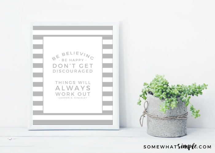 white frame with place for text with succulent in diy concrete pot. Skandinavian style room interior