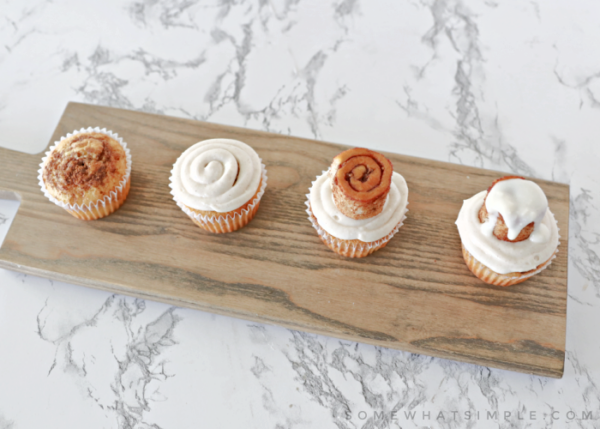 assembly line of cinnamon roll cupcakes