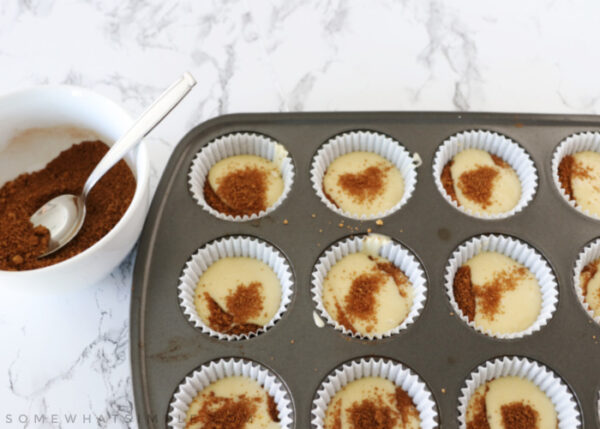 layering cinnamon roll cupcakes with batter and cinnamon mixture