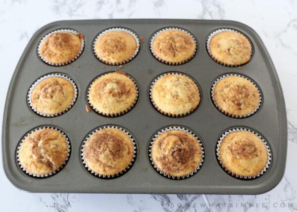 golden brown cupcakes in a cupcake pan