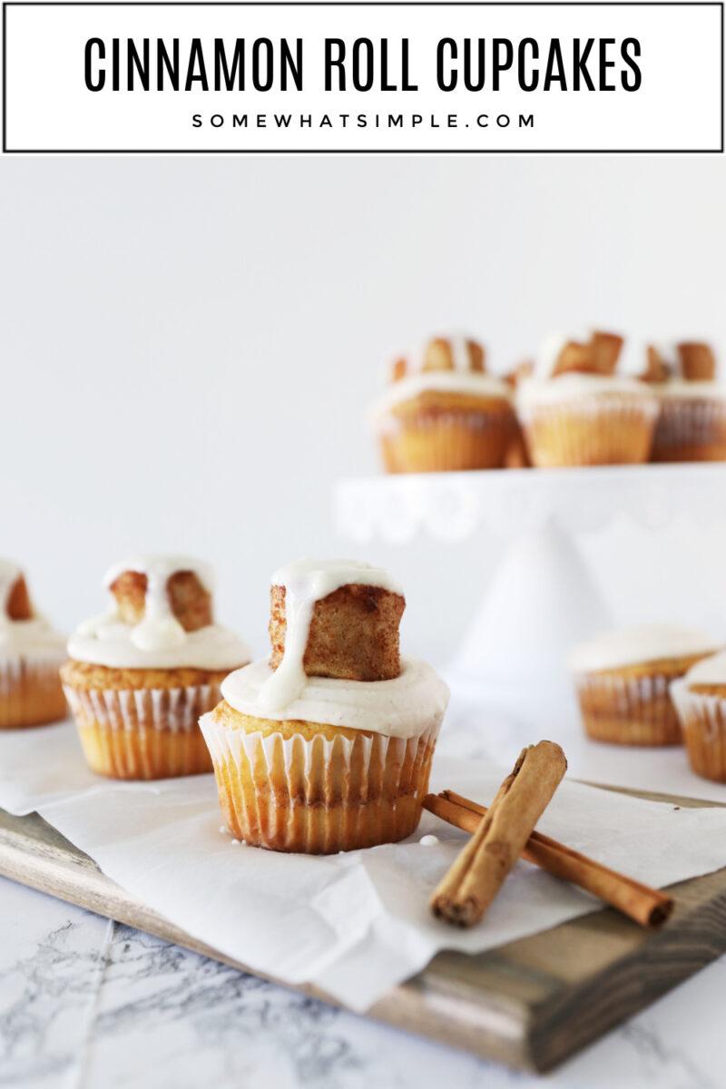 cinnamon roll cupcakes next to 2 cinnamon sticks