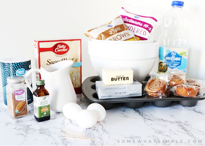 ingredients to make cinnamon roll cupcakes sitting on the counter