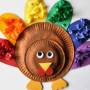Cute Turkey Craft for Kids where they match squares of colored paper to the coordinating color of feather on a turkey