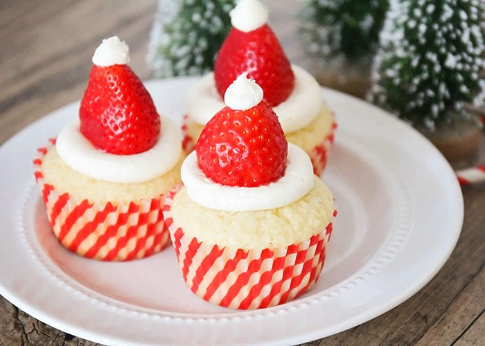 Santa Hat Cupcakes topped with fresh strawberries