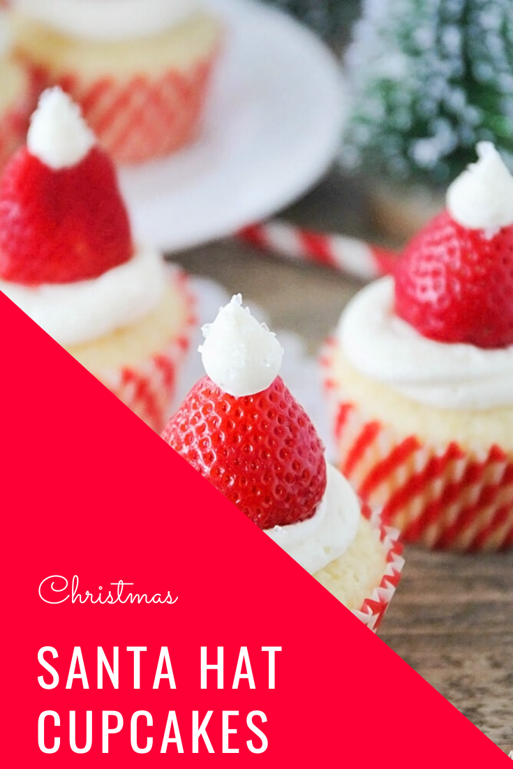 Santa hat cupcakes are a fun and festive dessert to serve during the Christmas holidays.  Topped with a fresh strawberry and homemade frosting, you won't be able to just eat one of these cupcakes. These are the perfect festive dessert idea to serve at your next Christmas party. via @somewhatsimple