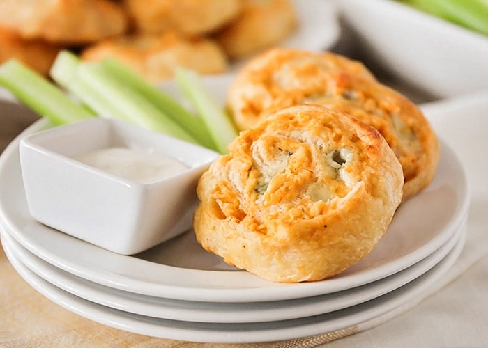 Buffalo Chicken Pinwheels on a white plate is a simple super bowl appetizer