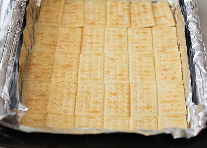 a baking sheet lined with club crackers